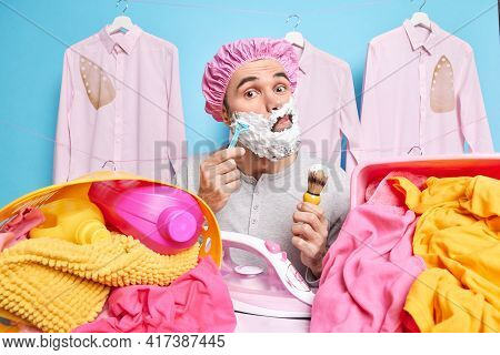 Busy Husband Irons Shaves At Same Time Removes Wrinkled On Washed Laundry Applies Foam Gel On Cheeks