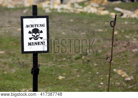 A Skull Sign With The Inscription Caution Mines In German