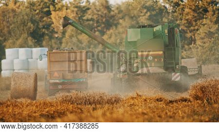 Warsaw, Poland 10.08.2020 - Unloading Pipe Of A Combine Harvester Ready To Pour Grains In The Wooden