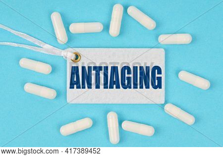 Medicine And Health Concept. There Is A Label On The Table Among The Pills That Says - Antiaging