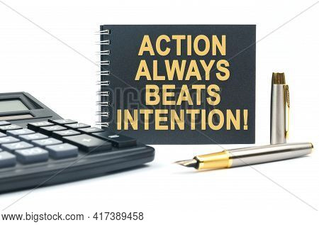 Business And Finance. On A White Background, There Is A Calculator, A Pen And A Black Notebook With