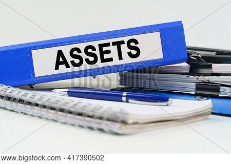 Business And Finance Concept. On The Table Are A Notebook, A Pen, Documents And A Folder With The In