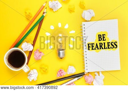 Business And Sports Concept. On A Yellow Background, A Cup Of Coffee, A Light Bulb, Pencils, A Noteb