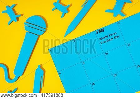 World Press Freedom Day Concept. May 3 On The Calendar. A Blue Microphone And A Pen Made Of Paper, A