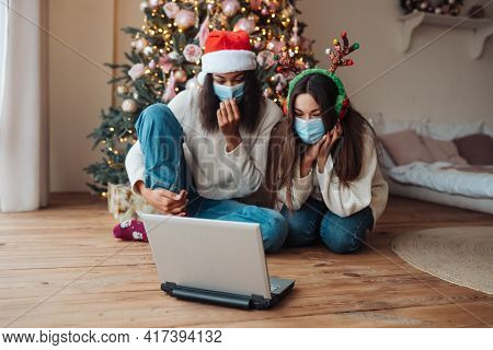 Two Girls While Speaking With Online Friend On Laptop