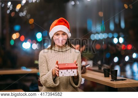 Portrait Happy Young Beautiful Woman, Hold Gift Box And Smile In Cafe.