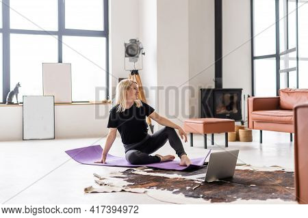 Seen From Behind Fit Sports Woman In Fitness Clothes In The Modern Living Room Using Online Fitness