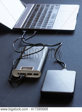 External Peripheral Gadgets: The Power Bank And Hard Drive Are Connected To A Laptop Or Ultrabook. C