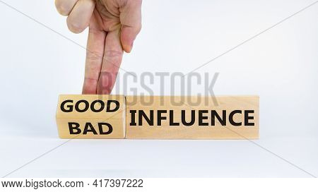 Good Or Bad Influence Symbol. Businessman Turns Cubes And Changed Words 'bad Influence' To 'good Inf