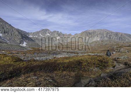 Hiking On Mccullough Gulch Trail Near Breckenridge, Colorado. Fall Time. Mountains And Cloudy Skies