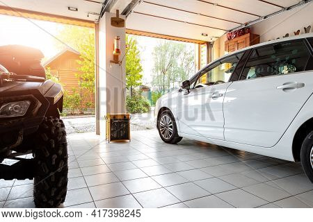 Home Suburban Countryside Modern Car And Atv Double Garage Interior With Wooden Shelf, Tools And Equ