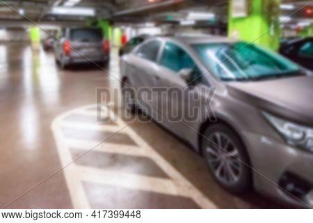 Parking Space Blurred. Empty Road Asphalt Background In Soft Focus. Car Lot Parking Space In Undergr