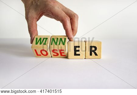 Loser Or Winner Symbol. Businessman Turns Cubes And Changes The Word 'loser' To 'winner'. Beautiful