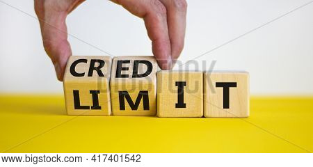 Credit Limit Symbol. Businessman Turns Wooden Cubes And Changes The Word 'limit' To 'credit'. Beauti