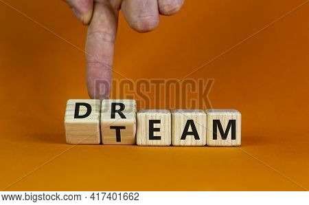 Dream Team Symbol. Businessman Turns Cubes And Changes The Word 'dream' To 'team'. Beautiful Orange