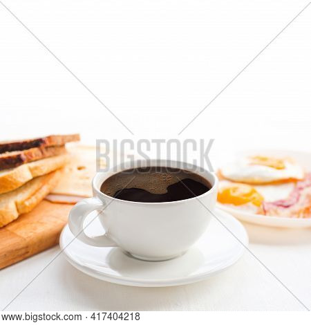 Breakfast With Coffee, Toasted Bread, Eggs, Bacon, Cold Cuts And Cheese On Table