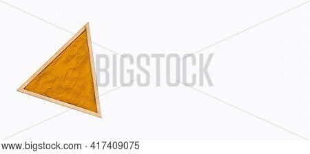 Curcuma Longa - Turmeric Powder In The Triangular Bowl
