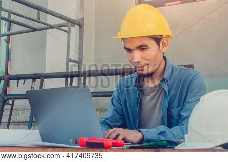 Man Using Computer Technology Working In Construction Site