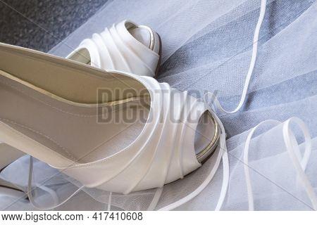 White Shoes Stood On A White Veil