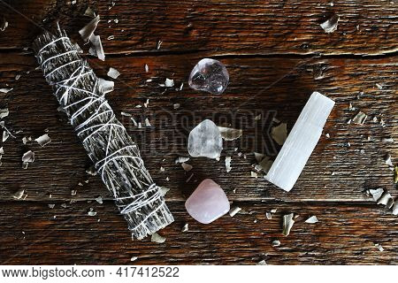 A Top View Image Of A White Sage Smudge Stick With Healing Crystals And Selenite Wand On A Dark Wood
