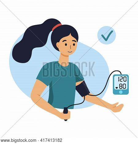 A Woman Measures Her Blood Pressure With A Blood Pressure Monitor.