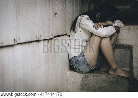 Women Sitting On The Floor  With Depression,  Family Problems,  Domestic Violence, Stop Violence And