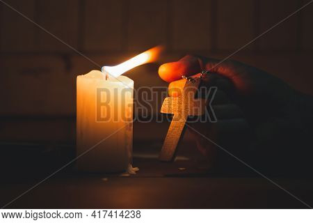 Woman Holding A Cross In Her Hands And Praying. Pray For Blessings From God. Concept Of Religion Fai