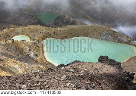 Tongariro Alpine Crossing Red Crater And Emerald Lakes Near The Peak Of Walk With Whisps Of Cloud Ag
