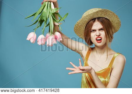 Emotional Woman In Golden Dress And Bouquet Of Flowers Displeasure Cropped View