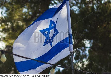 The Israeli Flag Moves In The Wind In Mount Herzl Park, Before The Israeli Independence Day