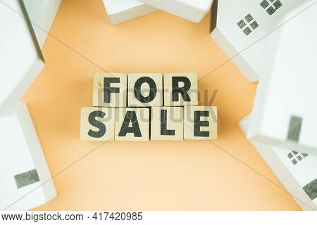 For Sell Text On Wooden Blocks With Wood White Home. Concept Of Selling Home