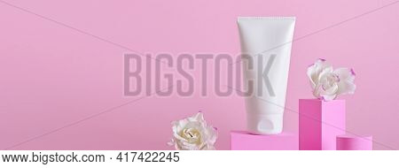 Banner With Beauty Natural Skincare Product. Cream Tube And Flowers On Different Geometric Podiums.