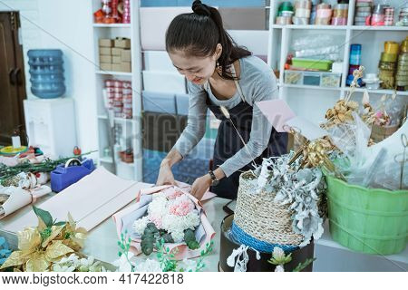 Smiling Woman Florist Working In Flower Shop Make Order Flannel Flower