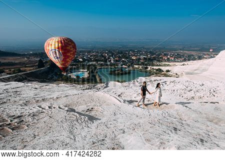 Couple In Love Among Balloons. Couple In Love In Pamukkale. Couple In Turkey. Honeymoon Trip. A Man
