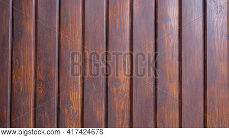Dark Brown Rustic Background From Planks Of Smoothly Polished Wood Treated With Stain, Country-style