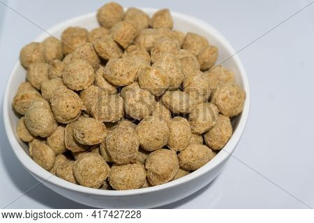 A Close Up Shot Of Soya Bean Nuggets In A Bowl With White Background. Soya Nuggets Are A Rich Source
