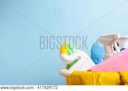 Cleaning Supplies Isolated On Blue Background. Cleaning Accessories. Isolate. Top View. Close Up.