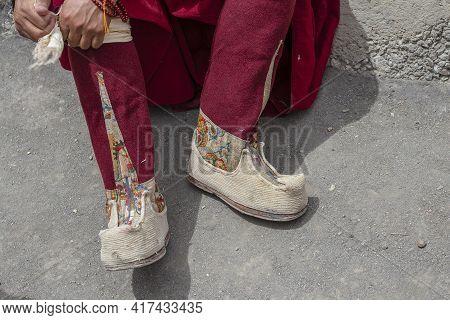 Footwear Worn By A Buddhist Monk During A Festival In Tibetan Monastery Near Mountain Village Leh In