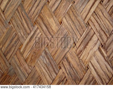 Texture Background Weaving Of Bamboo. High Quality Photo
