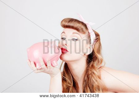 retro pinup woman with piggy bank as saving or spending concept