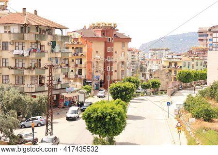 Turkey, Alanya, April 18, 2021. Alanya Street, Residential Buildings And Green Trees, Alanya