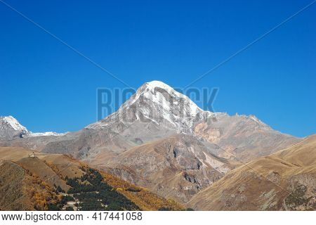 View Of Mount Kazbek In The Greater Caucasus Mountains Of Georgia In Autumn Time.