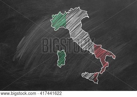 Country Map And Flag Of Italy Drawing With Chalk On A Blackboard. One Of A Large Series Of Maps And
