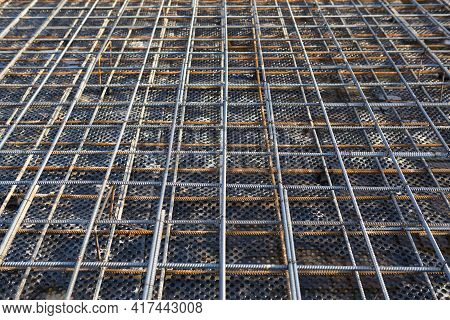 Iron Fittings On A Wooden Blind Area With Laid Pipes Are The Basis For Pouring The Foundation Of The