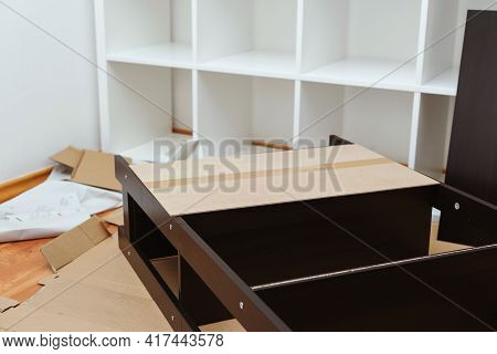 Furniture Assembly Yourself. Housing Furniture Theme. Man Assembling New Furniture At Home.