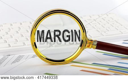 Magnifying Glass With The Word Margin On Chart Background