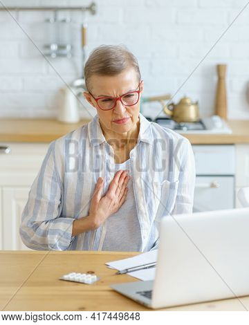 Sad Sick Middle Aged Woman Suffering From Pain In Chest Or Cough Having Online Consultation With Doc