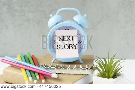 What Next Your Story Concept, Text Next Story On Paper Alarm Clock