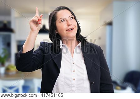 Cheerful Adult Corporate Business Woman Wearing Smart Casual Suit Making Good Idea Gesture With Fing