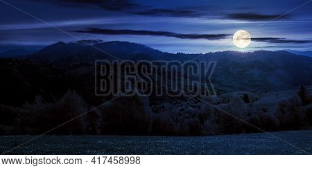 Rolling Rural Mountain Landscape At Night. Gorgeous Nature Scenery In Spring. Clouds On The Sky In F